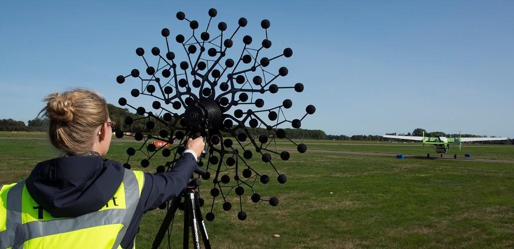TU Delft PhD researcher taking noise measurements